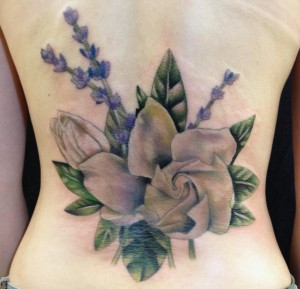 "Gardenia and Lavender coverup on the lower back. This piece inspired my drawing on the Art page titled, ""Botanically Spaced."""