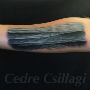 ocean surfers waves color tattoo